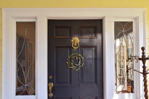 The front door of the Beers' home with its traditional lion head door knocker.